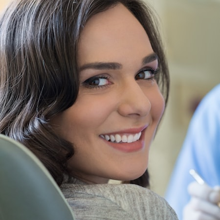 A smiling person to show how exams are essential to General Dentistry in Loganville GA