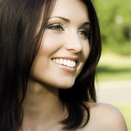 A smiling person who has enjoyed Loganville Cosmetic Dentistry and got porcelain veneers
