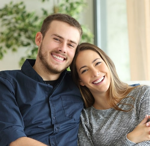 Young couple with beautiful smiles because of teeth whitening by our Loganville, GA experts.