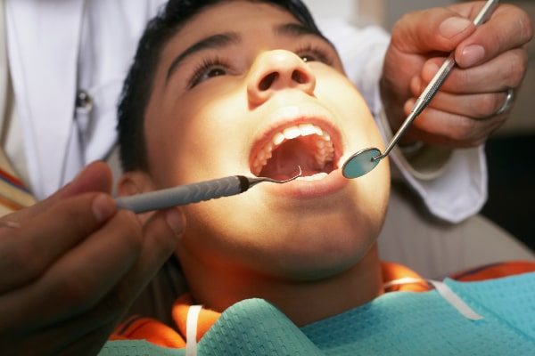 male getting a check-up in emergency dental visit